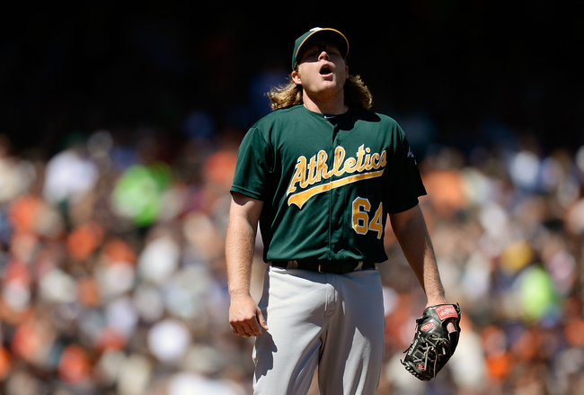 SAN FRANCISCO, CA - MAY 30:  Pitcher A.J. Griffin #64 of the Oakland Athletics react while he waits on manager Bob Melvin #6 to come take him out of the game in the six inning against the San Francisco Giants at AT&T Park on May 30, 2013 in San Francisco,