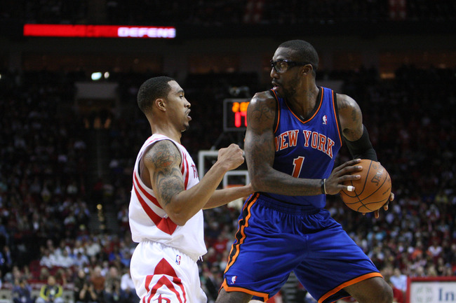 Jan 28, 2012; Houston, TX, USA; New York Knicks power forward Amare Stoudemire (1) posts up Houston Rockets shooting guard Courtney Lee (5) during the first quarter at the Toyota Center. Mandatory Credit: Thomas Campbell-US Presswire