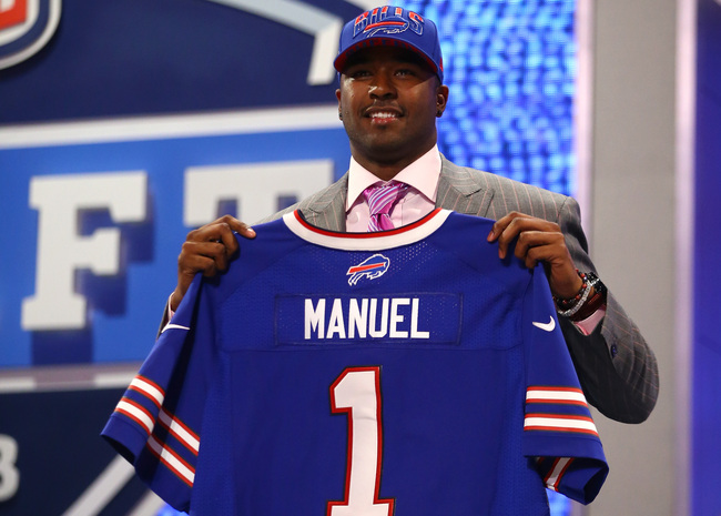 NEW YORK, NY - APRIL 25:  E.J. Manuel of the Florida State Seminoles holds up a jersey on stage after he was picked #16 overall by the Buffalo Bills in the first round of the 2013 NFL Draft at Radio City Music Hall on April 25, 2013 in New York City.  (Ph