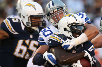 SAN DIEGO, CA - AUGUST 18:  Running back Ronnie Brown #30 of the San Diego Chargers is tackled by linebacker Sean Lee #50 of the Dallas Cowboys at Qualcomm Stadium on August 18, 2012 in San Diego, California.  (Photo by Stephen Dunn/Getty Images)