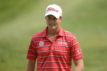 Webb Simpson, as the defending champion, smiles a lot.