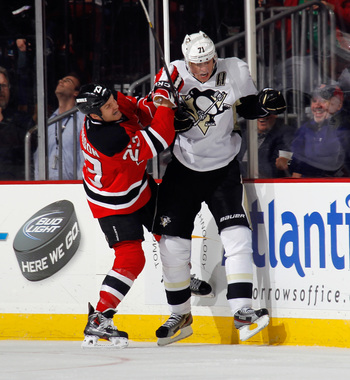 New Jersey Devil David Clarkson hits Pittsburgh Penguin Evgeni Malkin.