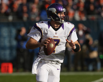 CHICAGO, IL - NOVEMBER 25: Christian Ponder #7 of the Minnesota Vikings rolls out to look for a receiver against the Chicago Bears at Soldier Field on November 25, 2012 in Chicago, Illinois. The Bears defeated the Vikings 28-10.  (Photo by Jonathan Daniel