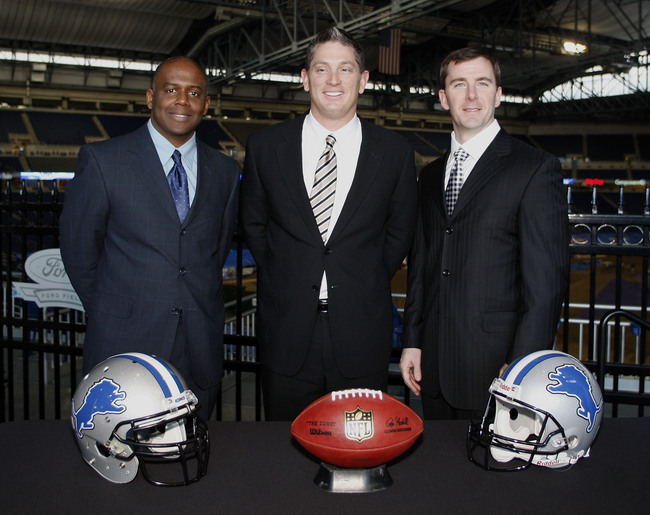 DETROIT , MI - JANUARY 16:  Jim Schwartz, center, head coach of the Detroit Lions poses with General Manager Martin Mayhew, left, and Tom Lewand team president after a press conference to introduce him as the Lions new head coach on January 16, 2009 at Fo