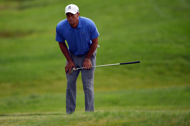 ARDMORE, PA - JUNE 13:  Tiger Woods of the United States reacts to missing a putt  on the ninth hole during Round One of the 113th U.S. Open at Merion Golf Club on June 13, 2013 in Ardmore, Pennsylvania.  (Photo by Drew Hallowell/Getty Images)