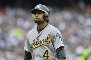 CHICAGO, IL- JUNE 9:   Coco Crisp #4 of the Oakland Athletics walks back to the dugout after popping out during the seventh inning against the Chicago White Sox at U.S. Cellular Field on June 9, 2013 in Chicago, Illinois. The White Sox defeated the Athlet