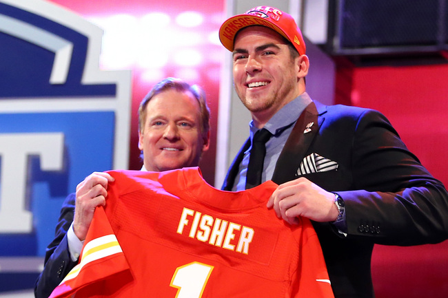 NEW YORK, NY - APRIL 25:  Eric Fisher (R) of Central Michigan Chippewas stands on stage with NFL Commissioner Roger Goodell after Fisher was picked #1 overall by the Kansas City Chiefs in the first round of the 2013 NFL Draft at Radio City Music Hall on A