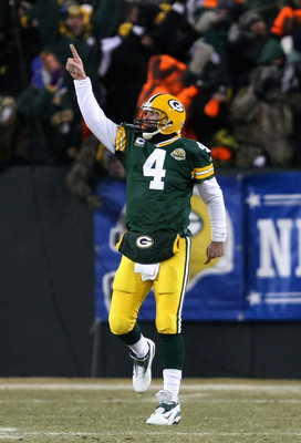 GREEN BAY, WI - JANUARY 20:  Quarterback Brett Favre #4 of the Green Bay Packers celebrates after throwing a 90 yard touchdown reception against the New York Giants during the NFC championship game on January 20, 2008 at Lambeau Field in Green Bay, Wiscon