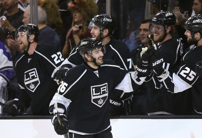LOS ANGELES, CA - JUNE 06:  Slava Voynov #26 of the Los Angeles Kings skates by the Kings bench to celebrate his goal with teammates in the first period of Game Four of the Western Conference Final against the Chicago Blackhawks during the 2013 NHL Stanle