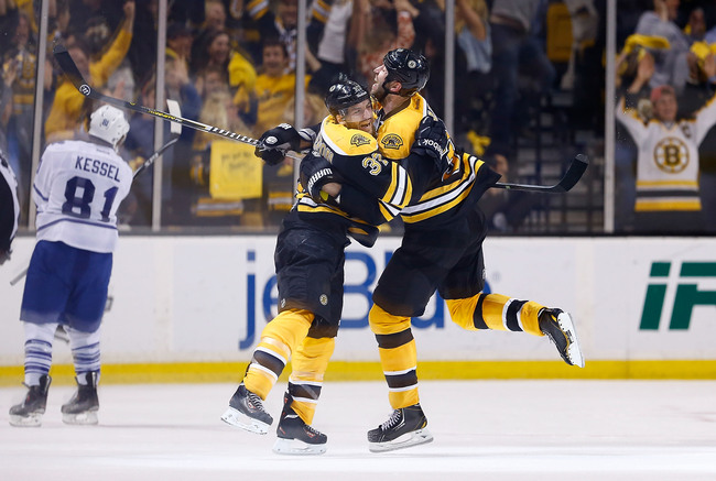 BOSTON, MA - MAY 13: Patrice Bergeron #37 and Zdeno Chara #33 of the Boston Bruins celebrate following Bergeron's game-winning overtime goal against the Toronto Maple Leafs in Game Seven of the Eastern Conference Quarterfinals during the 2013 NHL Stanley