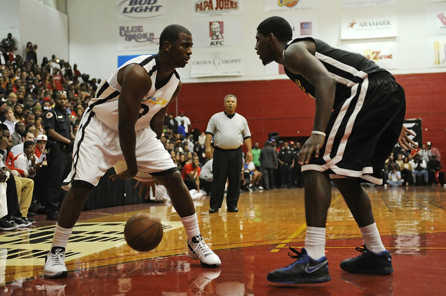 WINSTON-SALEM, NC - OCTOBER 01:  Chris Paul, #3 of the New Orleans Hornets, squares up one on one with Kyrie Irving, #3 of the Cleveland Cavaliers, during the CP3 All-Star pickup game at the Winston-Salem State University - C.E. Gaines Center on October 1