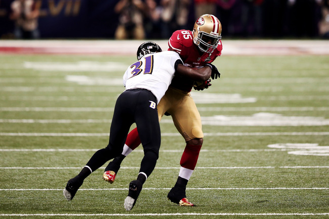 NEW ORLEANS, LA - FEBRUARY 03:  Vernon Davis #85 of the San Francisco 49ers makes a reception in the first quarter against Bernard Pollard #31 of the Baltimore Ravens during Super Bowl XLVII at the Mercedes-Benz Superdome on February 3, 2013 in New Orlean
