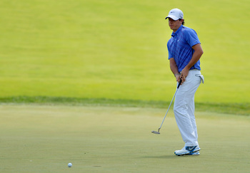 ARDMORE, PA - JUNE 15:  Rory McIlroy of Northern Ireland reacts to a missed putt for birdie on the fourth hole during Round Three of the 113th U.S. Open at Merion Golf Club on June 15, 2013 in Ardmore, Pennsylvania.  (Photo by Drew Hallowell/Getty Images)