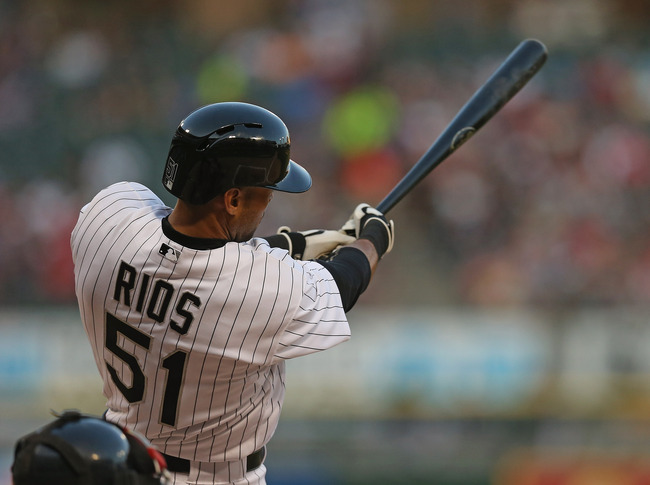 CHICAGO, IL - MAY 20: Alex Rios #51 of the Chicago White Sox extends his hitting streak with a single in the 1st inning against the Boston Red Sox at U.S. Cellular Field on May 20, 2013 in Chicago, Illinois. (Photo by Jonathan Daniel/Getty Images)