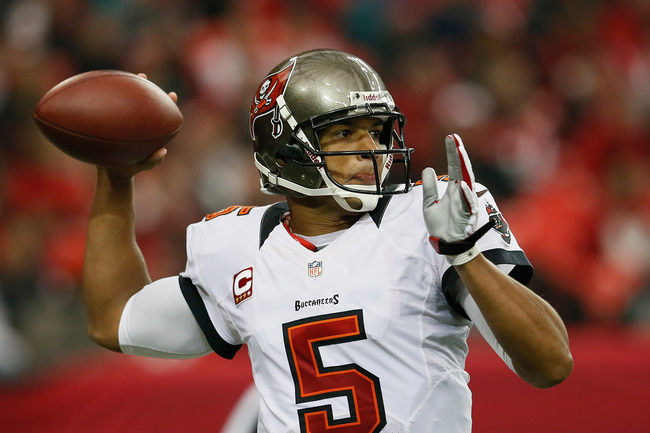 ATLANTA, GA - DECEMBER 30:  Josh Freeman #5 of the Tampa Bay Buccaneers passes against the Atlanta Falcons at Georgia Dome on December 30, 2012 in Atlanta, Georgia.  (Photo by Kevin C. Cox/Getty Images)