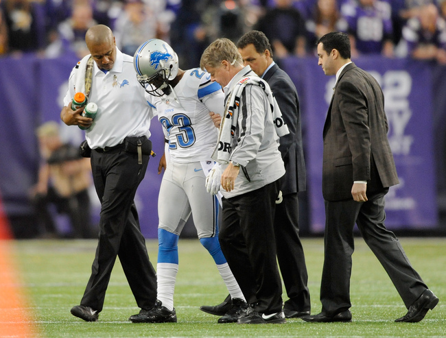 MINNEAPOLIS, MN - NOVEMBER 11: Chris Houston #23 of the Detroit Lions is helped off the field after an injury during the fourth quarter of the game against the Minnesota Vikings on November 11, 2012 at Mall of America Field at the Hubert H. Humphrey Metro