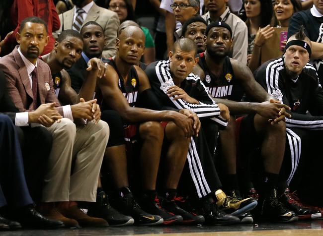 SAN ANTONIO, TX - JUNE 16:  (L-R) Juwan Howard #5, Chris Bosh #1, Ray Allen #34, Shane Battier #31, LeBron James #6 and Udonis Haslem #40 of the Miami Heat sit on the bench late in the fourth quarter while taking on the San Antonio Spurs during Game Five