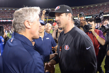 Oct 18, 2012; San Francisco, CA, USA; Seattle Seahawks coach Pete Carroll (left) shakes hands with San Francisco 49ers coach Jim Harbaugh after the game at Candlestick Park. The 49ers defeated the Seahawks 13-6.  Mandatory Credit: Kirby Lee/Image of Sport
