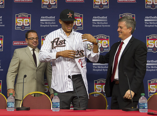 HOUSTON,TX-JUNE 07:  General manager Jeff Luhnow (R) of the Houston Astros along with Bobby Heck, Astros Assistant G.M./Director of Scouting, introduces Carlos Correa, the first-overall selection in the 2012 MLB First Year Player Draft during a press conf