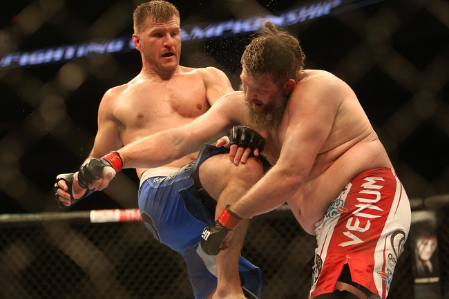 Jun 15, 2013; Winnipeg, MB, Canada; Roy Nelson (right) fights Stipe Miocic during their Heavyweight bout at UFC 161 at MTS Centre. Mandatory Credit: Tom Szczerbowski-USA TODAY Sports