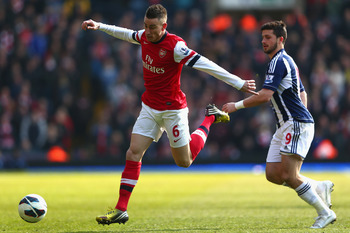 WEST BROMWICH, ENGLAND - APRIL 06:  Laurent Koscielny (L) of Arsenal  steps away from Shane Long (R) of West Bromwich Albion during the Barclays Premier League match between West Bromwich Albion and Arsenal at The Hawthorns on April 6, 2013 in West Bromwi