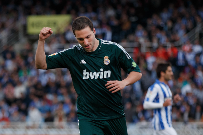 MADRID, SPAIN - MAY 26: Gonzalo Higuain of Real Madrid CF celebrates scoring their opening goal during the La Liga match between Real Sociedad de Futbol and Real Madrid CF at Estadio Anoeta on May 26, 2013 in San Sebastian, Spain. (Photo by Gonzalo Arroyo
