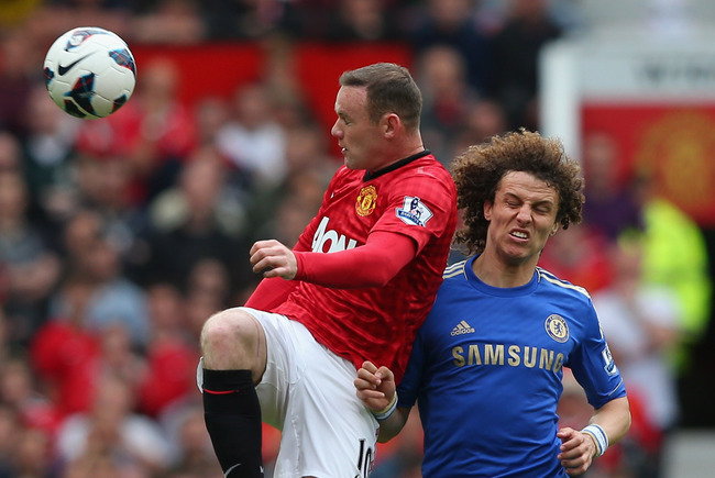 MANCHESTER, ENGLAND - MAY 05:  Wayne Rooney of Manchester United wins the ball from David Luiz of Chelsea during the Barclays Premier League match between Manchester United and Chelsea at Old Trafford on May 5, 2013 in Manchester, England.  (Photo by Alex