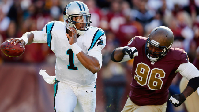 LANDOVER, MD - NOVEMBER 04: Quarterback Cam Newton #1 of the Carolina Panthers scrambles while being chased by nose tackle Barry Cofield #96 of the Washington Redskins during the second quarter at FedExField on November 4, 2012 in Landover, Maryland.  (Ph