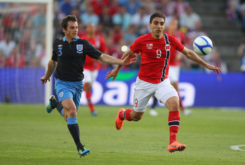 Abdellaoue (right) jostles with England's Leighton Baines