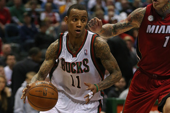 MILWAUKEE, WI - APRIL 28: Monta Ellis #11 of the Milwaukee Bucks drives past Chris Andersen #11 of the Miami Heat in Game Four of the Eastern Conference Quarterfinals during the 2013 NBA Playoffs at the Bradley Center on April 28, 2013 in Milwaukee, Wisco