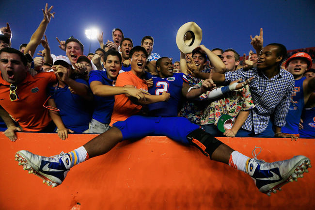GAINESVILLE, FL - OCTOBER 20:  Defensive lineman Dominique Easley #2 of the Florida Gators celebrates with fans following the Florida Gators victory over the South Carolina Gamecocks at Ben Hill Griffin Stadium on October 20, 2012 in Gainesville, Florida.