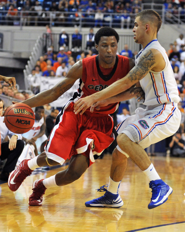 GAINESVILLE, FL - JANUARY 9:  Guard Kentavious Caldwell-Pope #1 of the Georgia Bulldogs drives on guard Scottie Wilbekin #5 of the Florida Gators January 9, 2013 at Stephen C. O'Connell Center in Gainesville, Florida. The Gators won 77 - 44. (Photo by Al