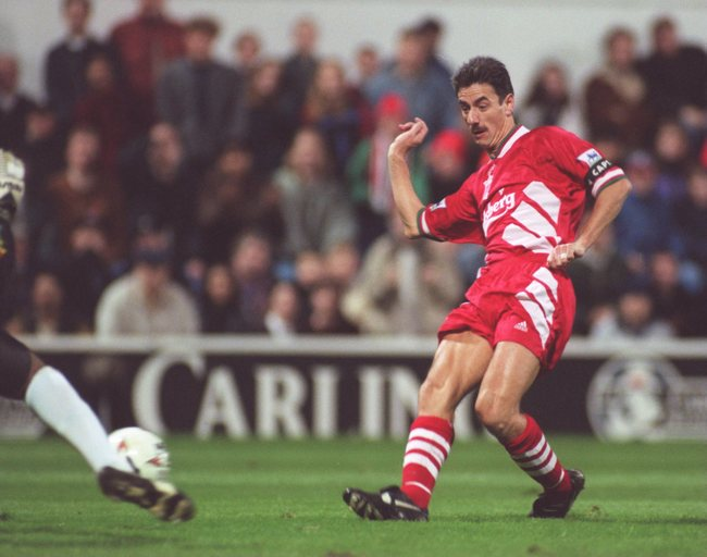 31 OCT 1994:  IAN RUSH OF LIVERPOOL TRIES TO GET PAST GOALKEEPER SIEB DYKSTRA OF QUEENS PARK RANGERS AS HE SHOOTS AT GOAL DURING THEIR PREMIERSHIP MATCH AT THE LOFTUS ROAD GROUND IN  LONDON. Mandatory Credit: Phil Cole/ALLSPORT