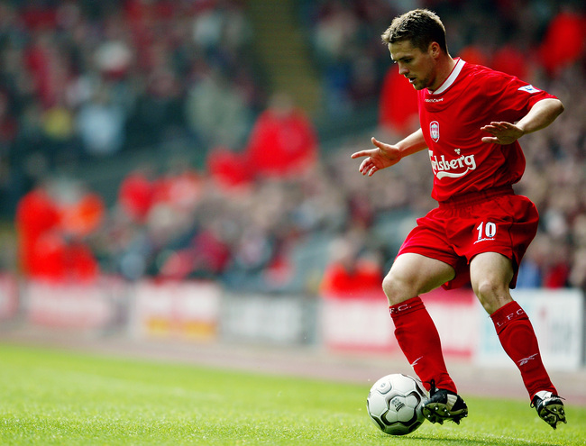 LIVERPOOL - APRIL 21:  Michael Owen of Liverpool with the ball at his feet during the FA Barclaycard Premiership match between Liverpool and Charlton Athletic held on April 21, 2003 at Anfield in Liverpool, England.  Liverpool won the match 2-1. (Photo by