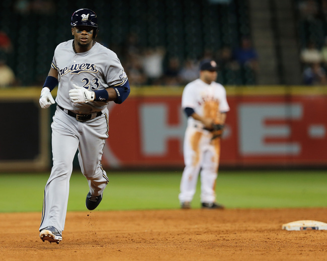 HOUSTON, TX - JUNE 19:  Rickie Weeks #23 of the Milwaukee Brewers rounds second base after his two-run home run to left field in the eighth inning off Hector Ambriz #62 of the Houston Astros at Minute Maid Park on June 19, 2013 in Houston, Texas.  (Photo
