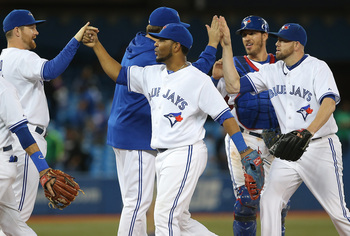 The Jays celebrate an 8-3 win over the Rockies on Tuesday.