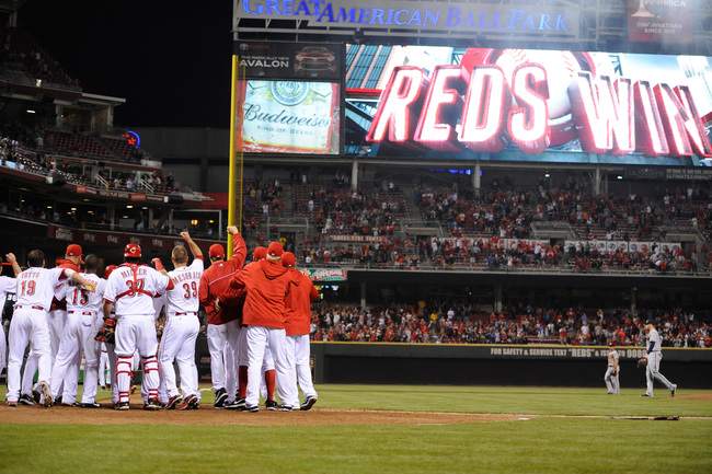 CINCINNATI, OH - MAY 7:  The Cincinnati Reds celebrate a ninth-inning walk off home run by Shin-Soo Choo #17 of the Cincinnati Reds to defeat the Atlanta Braves 5-4 at Great American Ball Park on May 7, 2013 in Cincinnati, Ohio.  (Photo by Jamie Sabau/Get