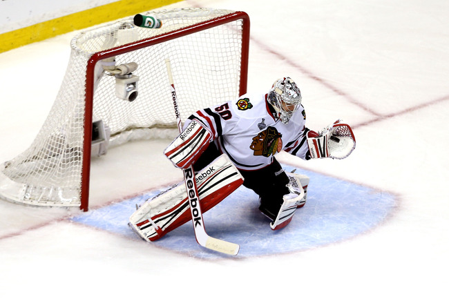 BOSTON, MA - JUNE 19: Corey Crawford #50 of the Chicago Blackhawks makes a save against the Boston Bruins in Game Four of the 2013 NHL Stanley Cup Final at TD Garden on June 19, 2013 in Boston, Massachusetts.  (Photo by Bruce Bennett/Getty Images)