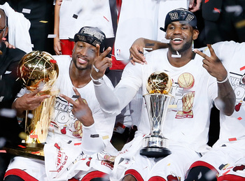 LeBron James and Dwyane Wade celebrating consecutive championship victories.