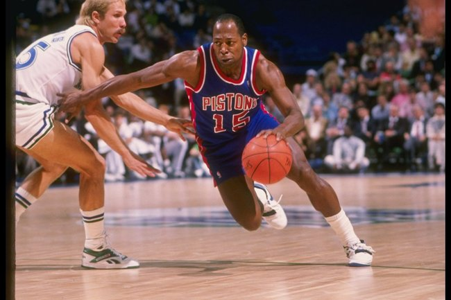 Undated:  Guard Vinnie Johnson of the Detroit Pistons (right) drives the ball past guard Brad Davis of the Dallas Mavericks during a game at Reunion Arena in Dallas, Texas. Mandatory Credit: Joe Patronite  /Allsport