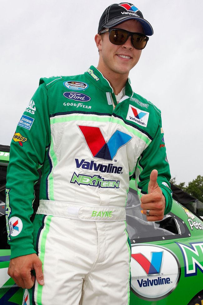 ELKHART LAKE, WI - JUNE 22:  Trevor Bayne, driver of the #6 Valvoline NextGen Ford, stands on the grid during qualifying for the NASCAR Nationwide Series Johnsonville Sausage 200 Presented by Menards at Road America on June 22, 2013 in Elkhart Lake, Wisco