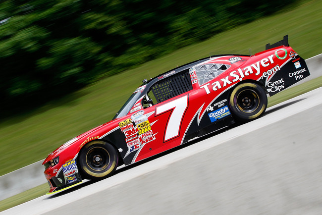 ELKHART LAKE, WI - JUNE 21:  Regan Smith drives the #7 TaxSlayer.com Chevrolet during practice for the NASCAR Nationwide Series Johnsonville Sausage 200 Presented by Menards at Road America on June 21, 2013 in Elkhart Lake, Wisconsin.  (Photo by Tyler Bar