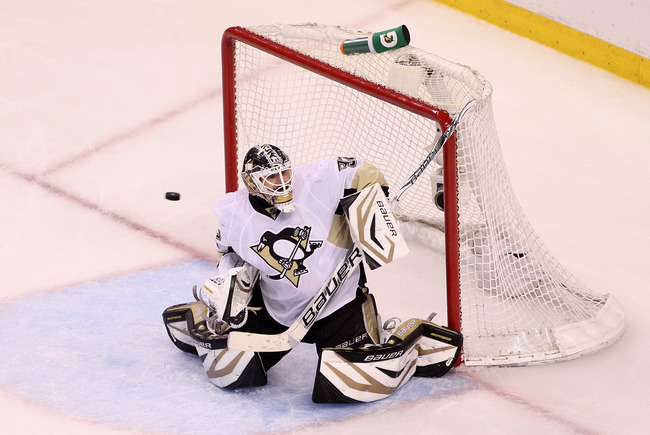 BOSTON, MA - JUNE 07: Tomas Vokoun #92 of the Pittsburgh Penguins tries to make a save as the puck goes off the crossbar in the third period against the Boston Bruins in Game Four of the Eastern Conference Final during the 2013 Stanley Cup Playoffs at TD
