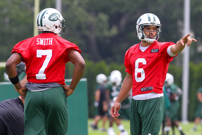 Jun 11, 2013; Florham Park, NJ, USA; New York Jets quarterback Geno Smith (7) and New York Jets quarterback Mark Sanchez (6) during the New York Jets minicamp session at the Atlantic Health Jets Training Center.  Mandatory Credit: Ed Mulholland-USA TODAY