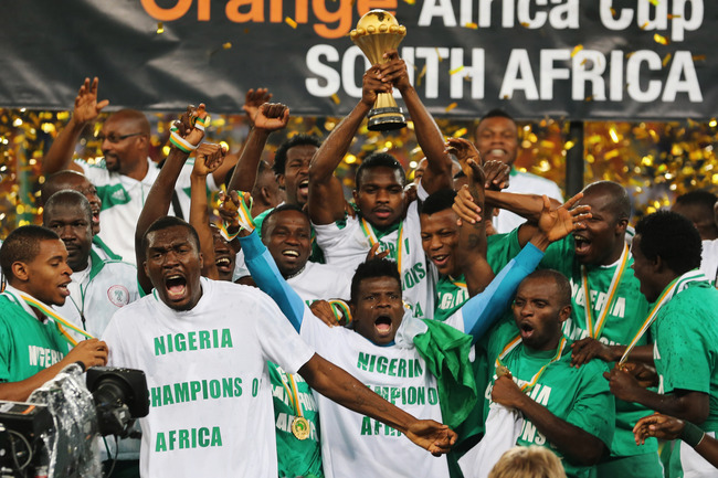JOHANNESBURG, SOUTH AFRICA - FEBRUARY 10:  Joseph Yobo and team mates celebrate with the trophy after winning the 2013 Africa Cup of Nations Final match between Nigeria and Burkina at FNB Stadium on February 10, 2013 in Johannesburg, South Africa.  (Photo