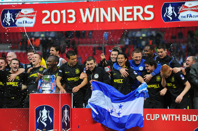 LONDON, ENGLAND - MAY 11:  Wigan players celebrate following their team's 1-0 victory during the FA Cup with Budweiser Final between Manchester City and Wigan Athletic at Wembley Stadium on May 11, 2013 in London, England.  (Photo by Mike Hewitt/Getty Ima