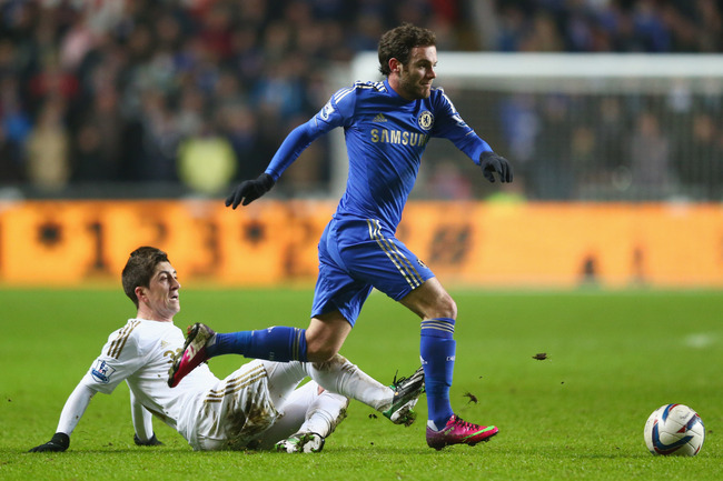 SWANSEA, WALES - JANUARY 23:  Juan Mata of Chelsea is challenged by Pablo Hernandez of Swansea City during the Capital One Cup Semi-Final Second Leg match between Swansea City and Chelsea at Liberty Stadium on January 23, 2013 in Swansea, Wales.  (Photo b