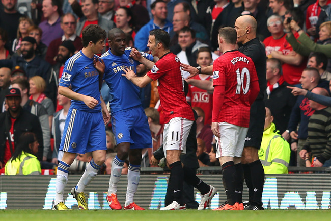 MANCHESTER, ENGLAND - MAY 05:  Ryan Giggs of Manchester United clashes with Oscar of Chelsea before Rafael Da Silva is sent off during the Barclays Premier League match between Manchester United and Chelsea at Old Trafford on May 5, 2013 in Manchester, En