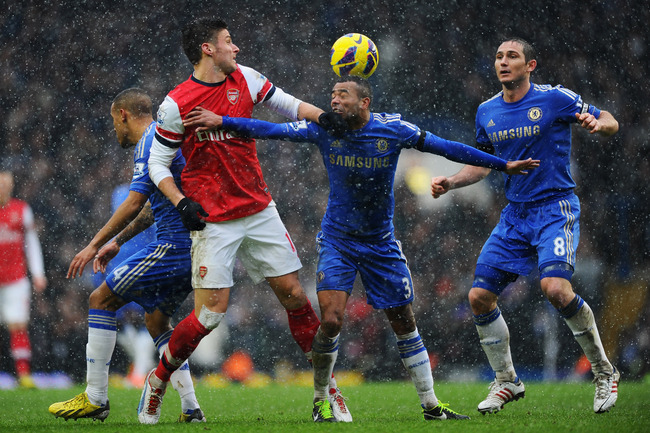 LONDON, ENGLAND - JANUARY 20:  Olivier Giroud of Arsenal battles with Ashley Cole (2R) and Frank Lampard of Chelsea (R) during the Barclays Premier League match between Chelsea and Arsenal at Stamford Bridge on January 20, 2013 in London, England.  (Photo