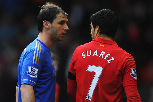 LIVERPOOL, ENGLAND - APRIL 21: Branislav Ivanovic of Chelsea talks with Luis Suarez of Liverpool as they walk in for half time during the Barclays Premier League match between Liverpool and Chelsea at Anfield on April 21, 2013 in Liverpool, England.  (Pho